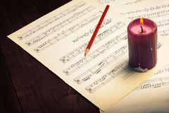 Music note and lit candle Royalty Free Stock Photo