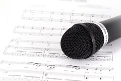 Music Note and microphone. Music Note and black microphone - focus to microphone royalty free stock photos