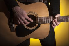 The composer plays brute force on an acoustic guitar. Music note notes strings hand composers artist tapping stock photos