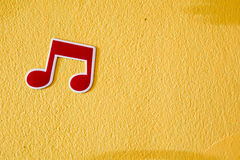 Free Music Note Plastic Sticker On Colorful Cement Wall Stock Images - 59558524