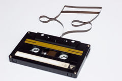 Music note sign. Cassette tape on white background. Film shaping music note royalty free stock photo