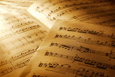 Music notes. Close-up view of music notes sheets Royalty Free Stock Photo