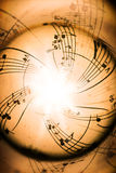 Music notes. On old brown paper with sphere effect Royalty Free Stock Photo