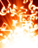 Music notes. In a fire like background Stock Image
