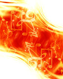 Music notes. Bright music notes on a fire like background Stock Image