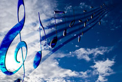 Music notes. Blue music notes on sunny sky