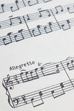 Music notes with allegretto Royalty Free Stock Photo