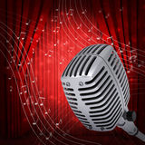 Music notes around studio microphone Royalty Free Stock Photos