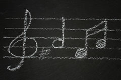 Music notes on black Stock Image