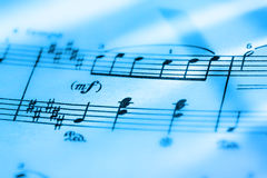 Music notes. In blue toning in closeup Stock Images