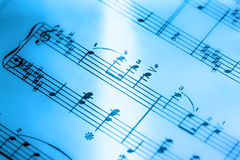 Music notes. In blue toning in closeup Royalty Free Stock Photos