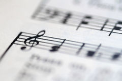 Music notes. Blurred music notes in a music book Stock Photos