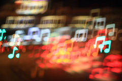 Music notes. Colorful bokeh music notes shape ,city  at night Royalty Free Stock Photos