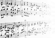 Music notes disappearing in the distance stock images