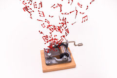 Music notes flying out of music box Royalty Free Stock Images
