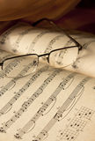 Music notes and glasses. Perspective view on Music notes and glasses stock photo