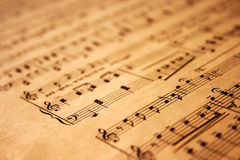 Music notes on grunge paper. Music notes on grunge old paper Stock Photos