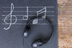Music notes with  headphones Royalty Free Stock Photography