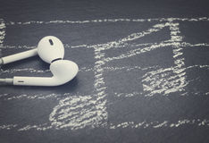 Music notes with  headphones Stock Image