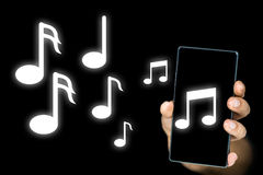 Music notes issuing from an mp3 player or mobile. Conceptual image of music notes issuing from an mp3 music player or notes depicting an audible musical ringtone Royalty Free Stock Photo