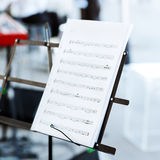 Music notes on music stand Stock Photo
