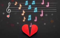 Music notes and note scale above red heart box, Valentines Day c. Colorful music notes and note scale above red heart box, Valentines Day concept royalty free stock images