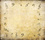 Music notes on old paper Royalty Free Stock Photos