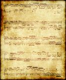 Music notes on old paper. Music notes by Bach on old brown vintage paper stock images