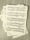 Music notes on old paper. Close up Stock Images