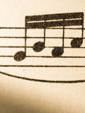 Music notes on old yellowed paper Royalty Free Stock Photo