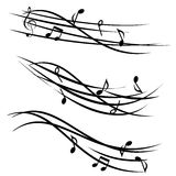 Music notes on ornamental staves Royalty Free Stock Photography