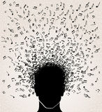 Music notes out from Head design Stock Photo