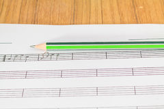 Music notes and pencil Royalty Free Stock Images