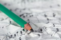 Music notes and pencil Stock Image
