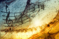 Music notes. With piano and background texture Stock Images