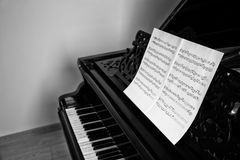 Music notes on piano. Indoors Stock Photo