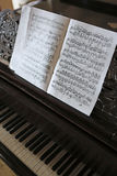 Music notes and piano keys Royalty Free Stock Photos