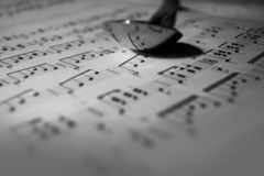 Music notes reflecting from a spoon royalty free stock image