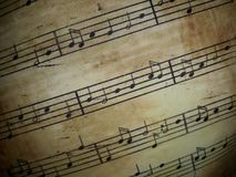 Music. Notes on sepia background Stock Images