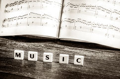 Music notes sheet and letters music Stock Photos