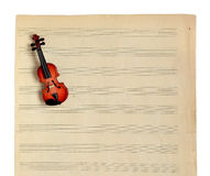 Music notes and violin. Royalty Free Stock Images