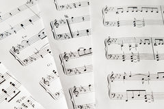 Music-notes on white paper closeup no background