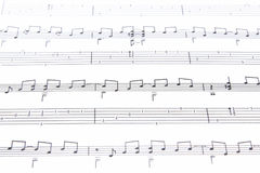 Music notes. On white paper sheet Stock Photo