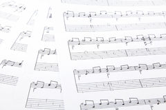 Music notes. On white paper sheet Stock Image