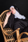 Music nun with candy Royalty Free Stock Image