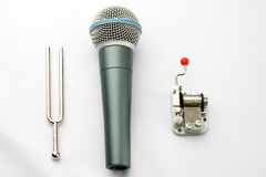 A pitchfork, a microphone and a carillon. Music objects: a pitchfork, a microphone and a carillon Royalty Free Stock Image