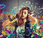 Music passion. Girl listen to music between colorful notes Stock Image