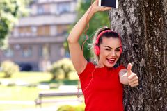Music passion- Cool woman with headphones listening to music. Music passion- Happy cool woman with headphones listening to music royalty free stock images