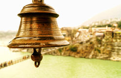 Music of Peace. Image of a ancient metallic rusted bell often denoted as symbol of Liberation,freedom and peace in Hindu culture hanging outside a temple with Royalty Free Stock Image