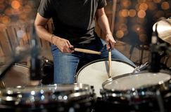 Musician playing drum kit at concert over lights Stock Photo
